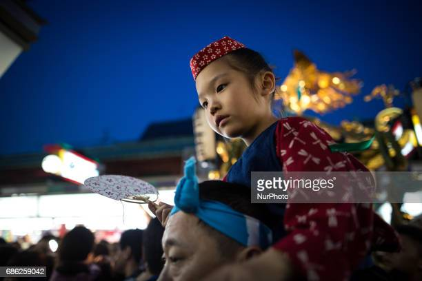 Festival goer is seen in traditional festival uniform during the Sanja Festival in front of in Sensoji Temple in Asakusa Tokyo on May 20 2017 These...