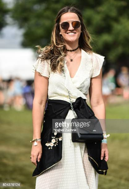 A festival goer is seen wearing a white dress and black with floral print jacket during the 2017 Panorama Music Festival day 2 at Randall's Island on...