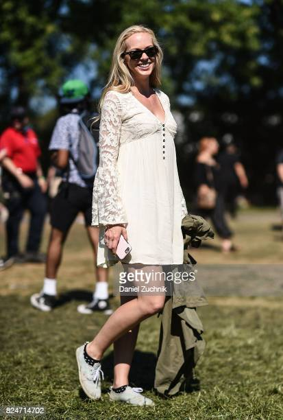 A festival goer is seen wearing a white dress during the 2017 Panorama Music Festival Day 3 at Randall's Island on July 30 2017 in New York City