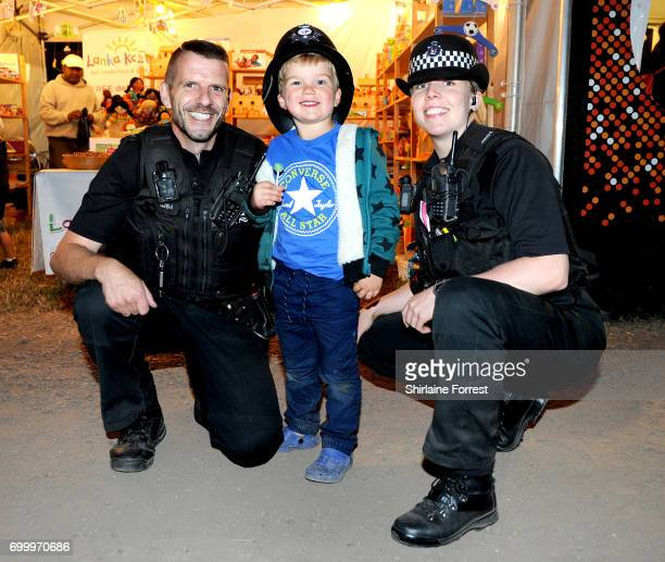 Festival goer Milo meets police officers during the Glastonbury Festival 2017 at Worthy Farm Pilton on June 22 2017 in Glastonbury England