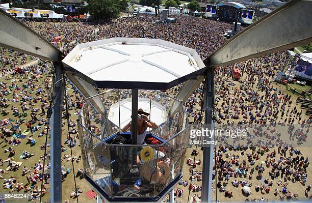 A festival goer takes a picture inside the big wheel fun fair ride at the Isle of Wight Festival on June 14 2009 in Newport Isle of Wight The...