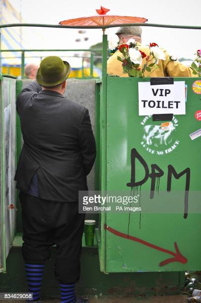 A festival goer uses the toilet during day two of the Glastonbury Festival Somerset