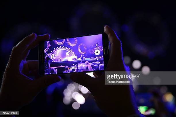 A festival goer uses their Samsung Galaxy s7 to record Red Hot Chili Peppers as they perform on the Samsung Stage at Lollapalooza 2016 Day 3 at Grant...