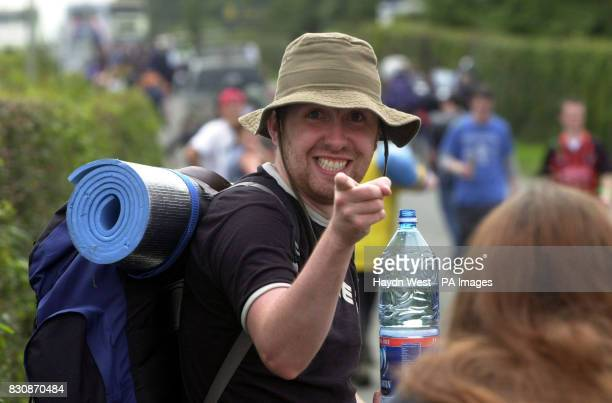 A festival goer walking towards the Witness rock festival Fairyhouse Republic of Ireland where over 80 acts will perform over two days including the...