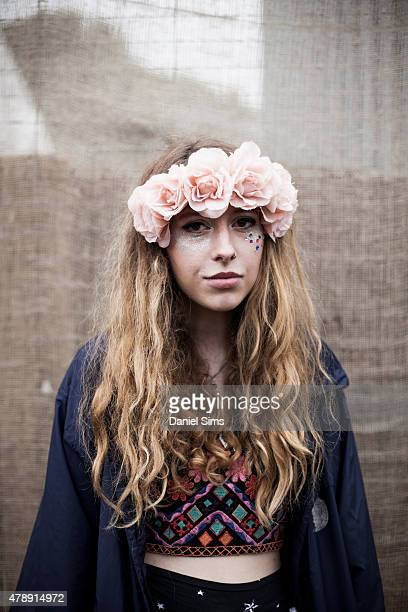 Festival goer wearing a flower head band at the Glastonbury Festival at Worthy Farm Pilton on June 28 2015 in Glastonbury England
