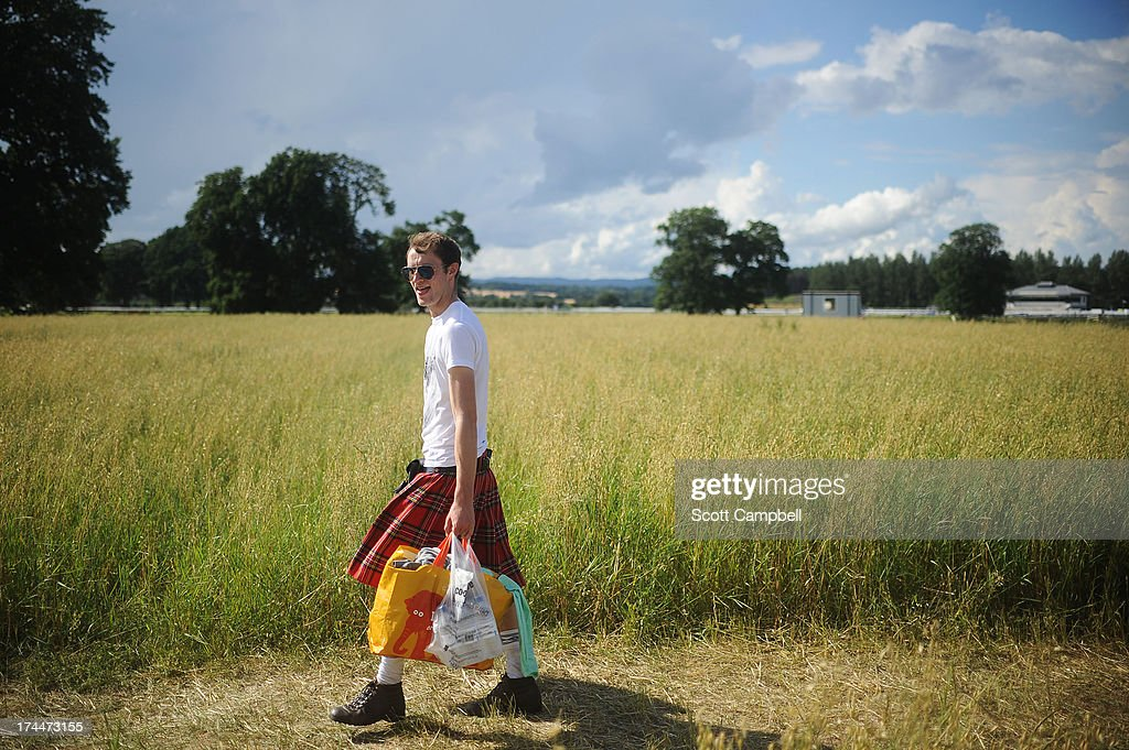 A festival goer wearing a kilt arrives at 80s Rewind Festival at Scone Palace on July 26, 2013 in Perth, Scotland.