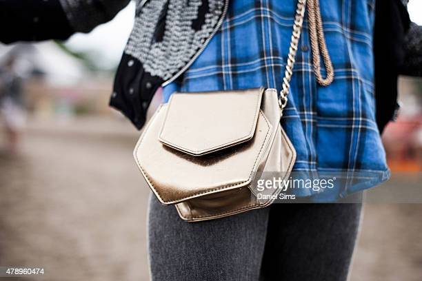 Festival goer wearing a metallic bag at the Glastonbury Festival at Worthy Farm Pilton on June 28 2015 in Glastonbury England
