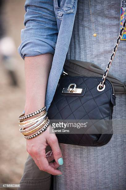 Festival goer wears a DKNY bag at the Glastonbury Festival at Worthy Farm Pilton on June 27 2015 in Glastonbury England