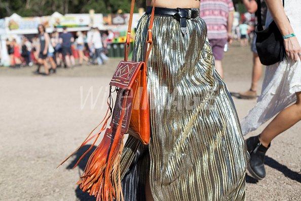 Festival Goer wears a gold...