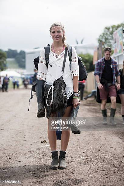 Festival goer wears a New Look top and HM shorts at the Glastonbury Festival at Worthy Farm Pilton on June 28 2015 in Glastonbury England