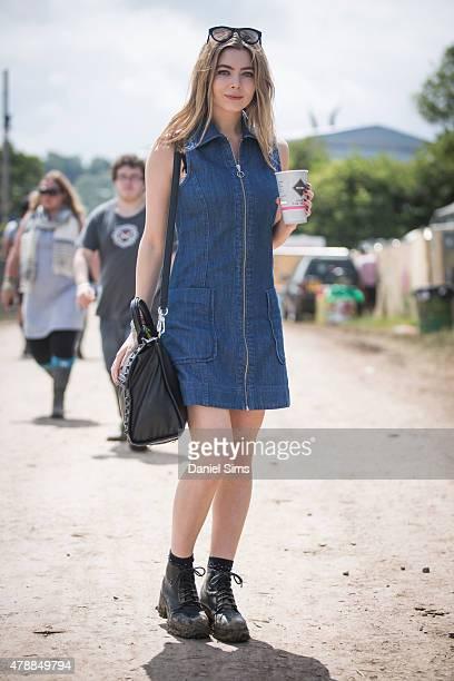 Festival goer wears a Topshop dress at the Glastonbury Festival at Worthy Farm Pilton on June 27 2015 in Glastonbury England