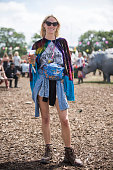 Festival goer wears an ASOS shawl at the Glastonbury Festival at Worthy Farm Pilton on June 27 2015 in Glastonbury England