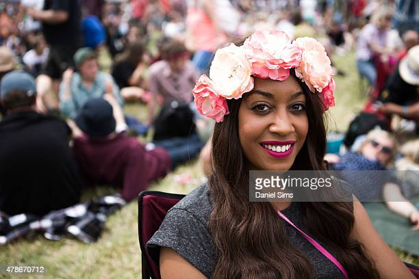 A festival goer with a flower head band at the Glastonbury Festival at Worthy Farm Pilton on June 26 2015 in Glastonbury England