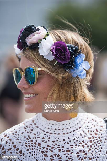 Festival goer with a flower head band at the Glastonbury Festival at Worthy Farm Pilton on June 27 2015 in Glastonbury England