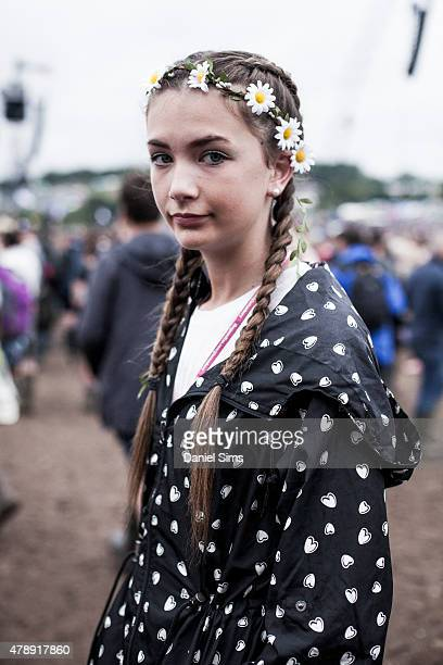 Festival goer with french plaits and a flower head band at the Glastonbury Festival at Worthy Farm Pilton on June 28 2015 in Glastonbury England