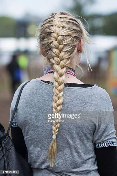 Festival goer with platted hair at the Glastonbury Festival at Worthy Farm Pilton on June 27 2015 in Glastonbury England