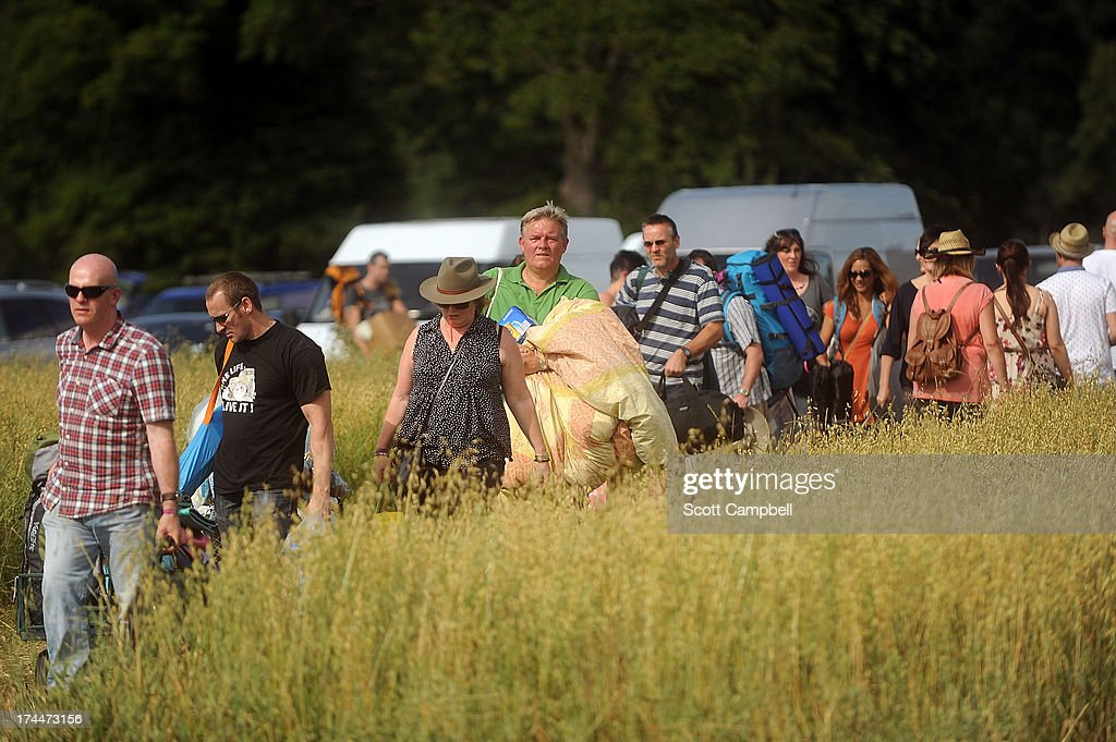 Festival goers arrive at 80s Rewind Festival at Scone Palace on July 26, 2013 in Perth, Scotland.