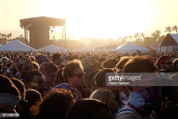 Festival goers at sunset during day 1 of the 2016 Coachella Valley Music Arts Festival Weekend 1 at the Empire Polo Club on April 15 2016 in Indio...