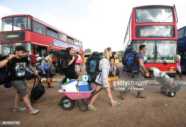 Festival goers at the bus station for transport leaving the Glastonbury Festival at Worthy Farm in Somerset
