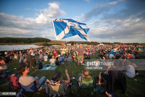 Festival goers at the main stage of the Wickerman Festival at Dundrennan on July 25 2014 in Dumfries United Kingdom