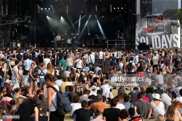 Festival goers attend a concert during the Solidays music festival in Paris on June 26 2015 AFP PHOTO / THOMAS SAMSON