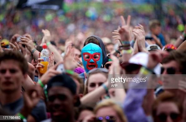 Festival goers attend concerts at the Pyramid Stage during the third day of the Glastonbury Festival of Contemporary Performing Arts near Glastonbury...