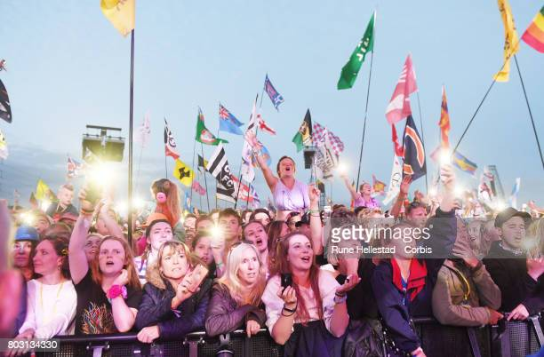 Festival goers attend day 4 of the Glastonbury Festival 2017 at Worthy Farm Pilton on June 25 2017 in Glastonbury England