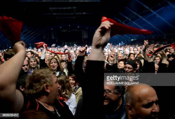 Festival goers attend the French singer Renaud Sechan's concert at the 41th edition of 'Le Printemps de Bourges' rock and pop music festival in...