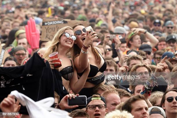 Festival goers attend the performance of 'Sum 41' group at the 'Rock am Ring' music festival on June 3 2017 in Nuerburg Germany's biggest rock...