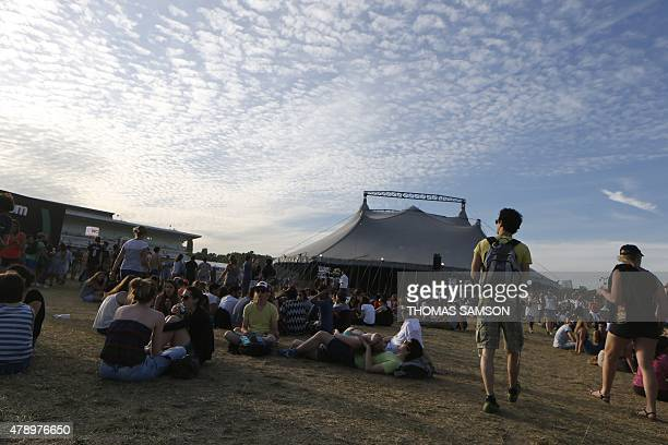 Festival goers attend the Solidays music festival in Paris on June 27 2015 AFP PHOTO / THOMAS SAMSON
