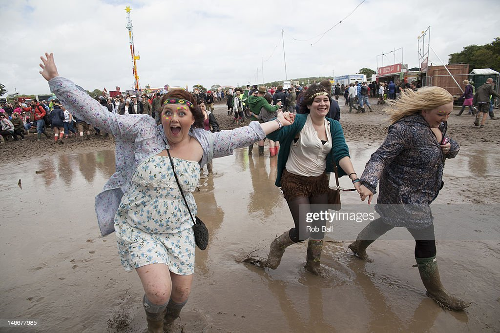 Festival goers brave the mud at the Isle Of Wight Festival at Seaclose Park on June 22, 2012 in Newport, Isle of Wight.