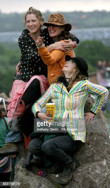 Festival goers celebrate the mid summer solstice at the stone circle at the Glastonbury Festival at Worthy Farm in Pilton Somerset