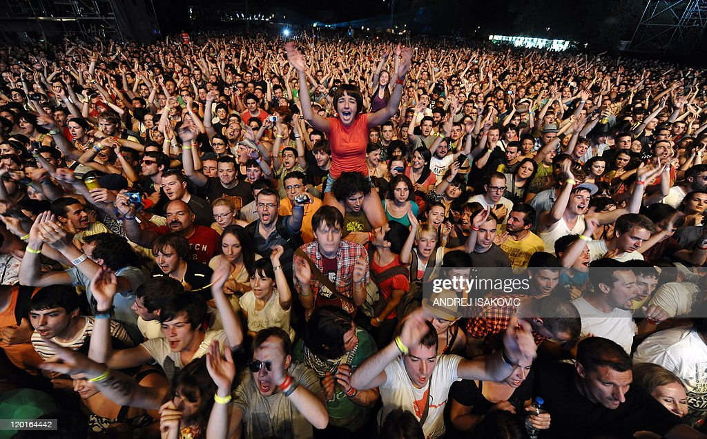 Festival goers cheer during a concert at the EXIT festival near Novi Sad on July 7, 2011. More than 150 acts are lined up for the EXIT rock and pop music festival, including Arcade Fire, Pulp, Grinderman, Portishead, M.I.A. and numerous DJs, performing at 16 different stages. The festival has been held since 2000 at an old fortress overlooking the River Danube in Novi Sad city.