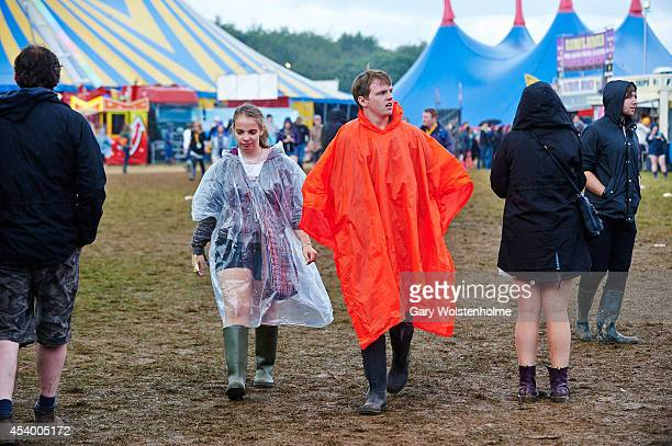 Festival goers endure heavy rain showers during the second day of Leeds Festival at Bramham Park on August 23 2014 in Leeds United Kingdom