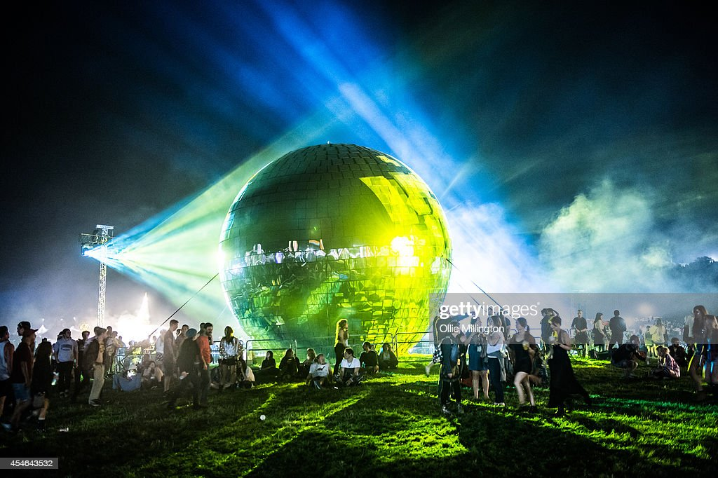 Festival goers enjoy the atmosphere around the official Guinness World Record holding Largest Disco Ball on the first nigh at the end of Day 1 of...