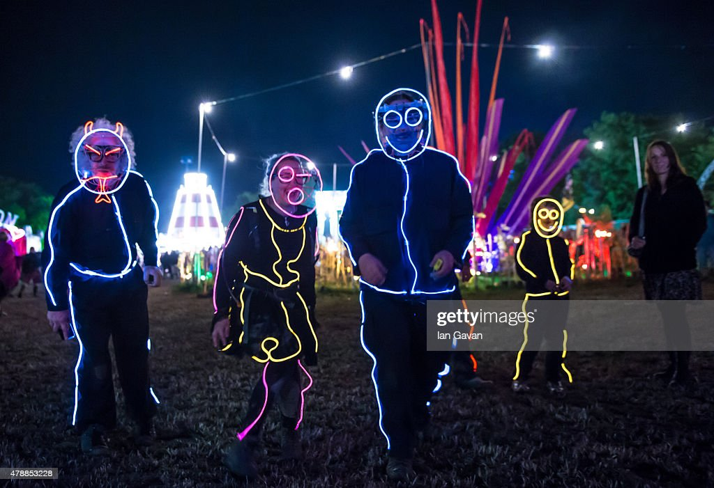 Festival goers enjoy the atmosphere at the Glastonbury Festival at Worthy Farm, Pilton on June 28, 2015 in Glastonbury, England. Now its 45th year the festival is one largest music festivals in the world and this year features headline acts Florence and the Machine, Kanye West and The Who. The Festival, which Michael Eavis started in 1970 when several hundred hippies paid just £1, now attracts more than 175,000 people.