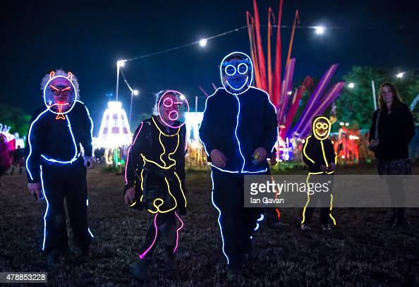 Festival goers enjoy the atmosphere at the Glastonbury Festival at Worthy Farm Pilton on June 28 2015 in Glastonbury England Now its 45th year the...