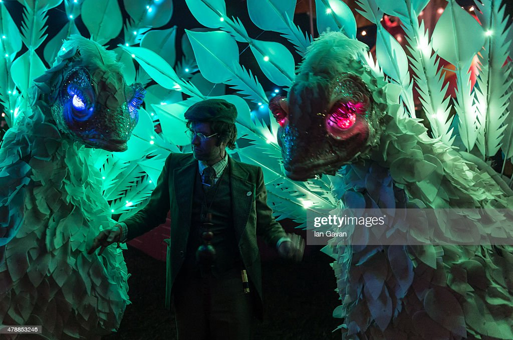 Festival goers enjoy the atmosphere at the Glastonbury Festival at Worthy Farm Pilton on June 27 2015 in Glastonbury England Now its 45th year the...