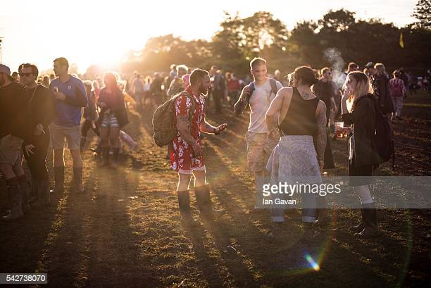 Festival goers enjoy the atmosphere at the Glastonbury Festival at Worthy Farm Pilton on June 23 2016 in Glastonbury England Now in its 46th year the...