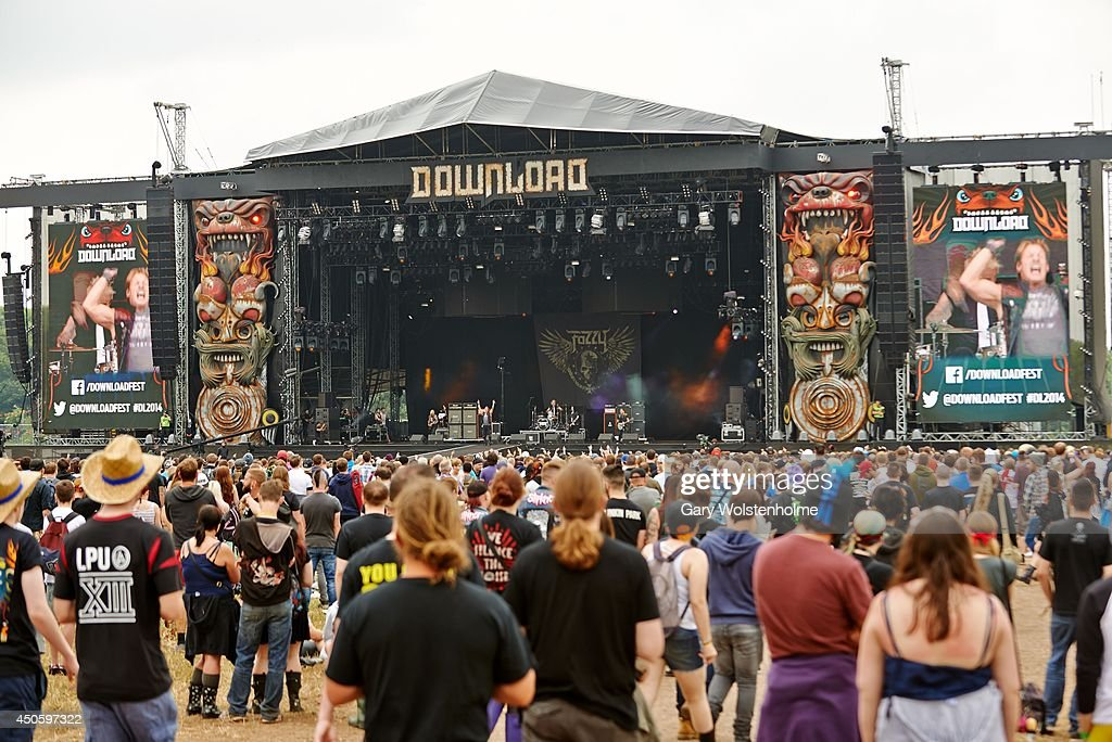 Festival goers enjoy the atmosphere by the Main Stage at Donnington Park on June 14, 2014 in Donnington, United Kingdom.