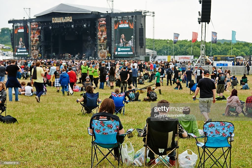 Festival goers enjoy the atmosphere by the main stage during day 2 of Download Festival at Donnington Park on June 14, 2014 in Donnington, United Kingdom.