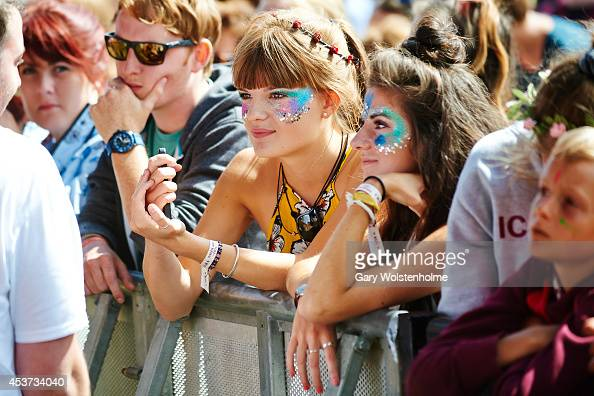 Festival goers enjoy the atmosphere during the final day of Green Man Festival at Glanusk Park on August 17 2014 in Brecon United Kingdom