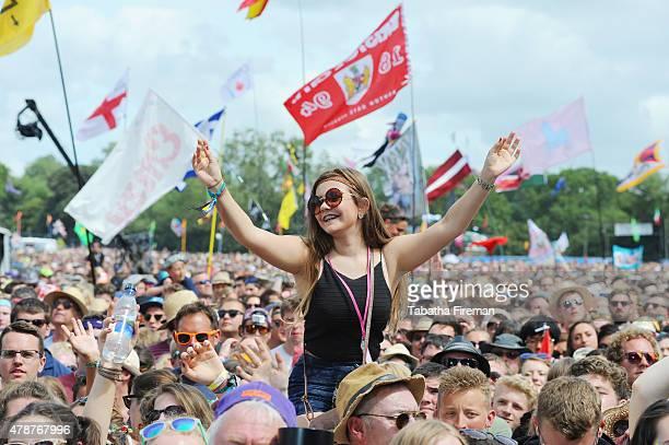 Festival goers enjoy the crowd for George Ezra at the Glastonbury Festival at Worthy Farm Pilton on June 27 2015 in Glastonbury England