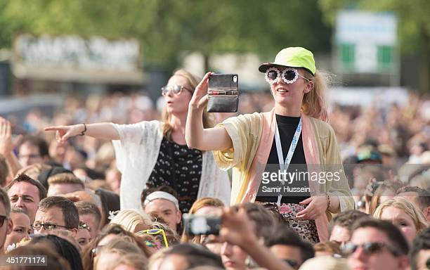 Festival goers enjoy the music at the Wireless Festival at Finsbury Park on July 6 2014 in London United Kingdom