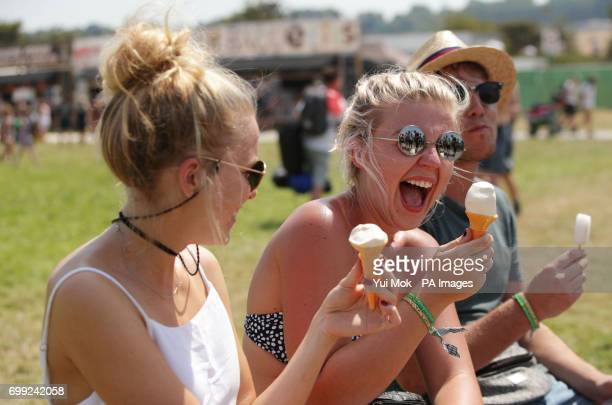 Festival goers enjoying an ice cream during the Glastonbury Festival at Worthy Farm in Pilton Somerset