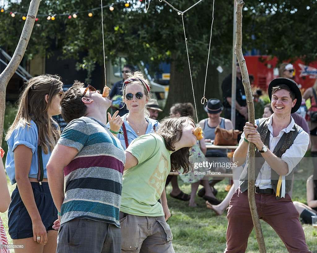 Festival goers enjoying the atmosphere during the Wilderness Festival at Cornbury Park on August 10, 2012 in Oxford, United Kingdom.