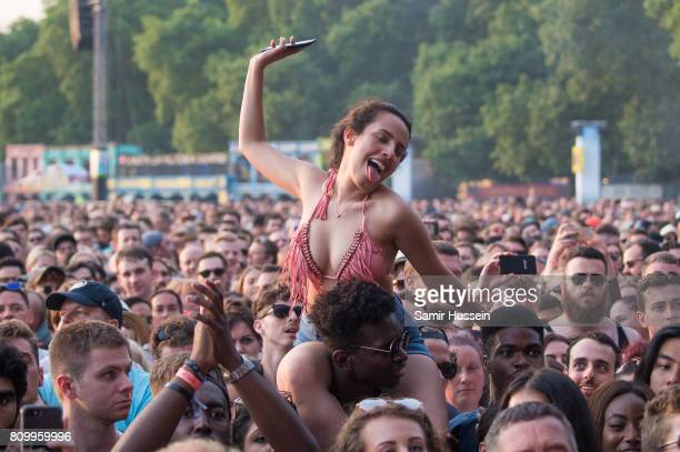 A festival goers enjoys Kings Of Leon perform on stage at the Barclaycard Presents British Summer Time Festival in Hyde Park on July 6 2017 in London...