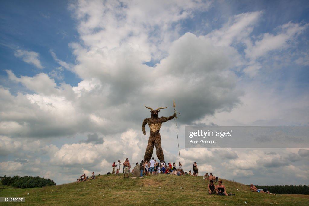 Festival goers gather under the Wickerman on day two of The Wickerman festival on July 27, 2013 in Dundrennan, Scotland.