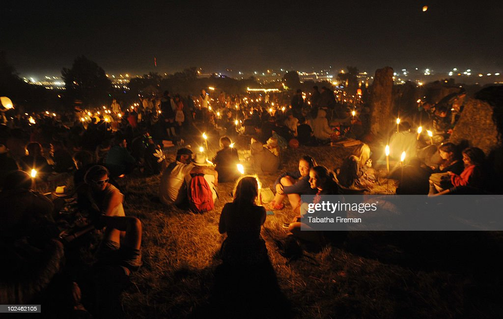 Festival goers head up to the stone circle to wait for the sun rise on the final day of Glastonbury Festival at Worthy Farm on June 27, 2010 in Glastonbury, England.