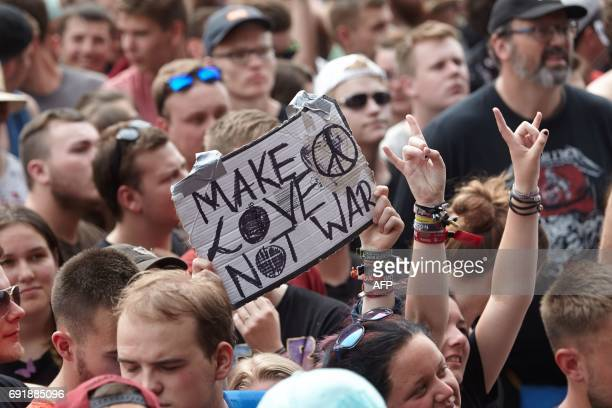Festival goers hold a banner at the 'Rock am Ring' music festival on June 3 2017 in Nuerburg during a performance of 'Sum 41' group Germany's biggest...